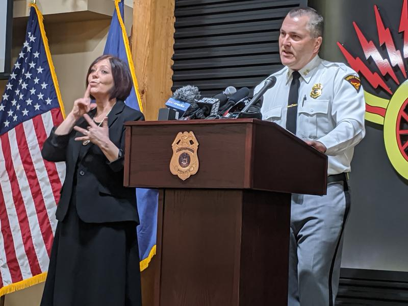 Town of Amherst Police Chief John Askey speaks Wednesday about the department's new program for communicating with deaf and hard-of-hearing citizens, while a sign language interpreter interprets for him.